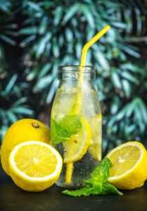 photo of lemon juice in glass bottle